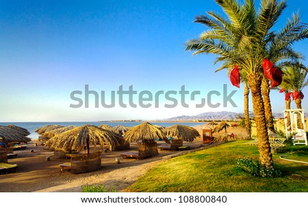 Warm empty  beach wait visitors by daybreak. - stock photo