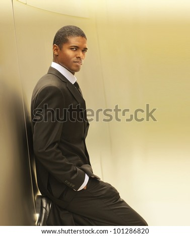 Warm golden portrait of a confident young businessman with copy space - stock photo