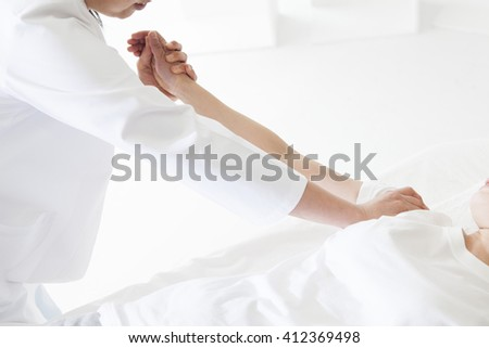 Warm hand will heal the mind and body.My hands will soothe your tired. - stock photo
