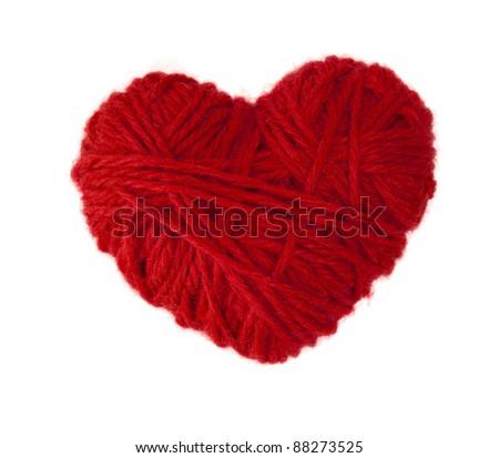 warm heart made of red wool yarn - stock photo