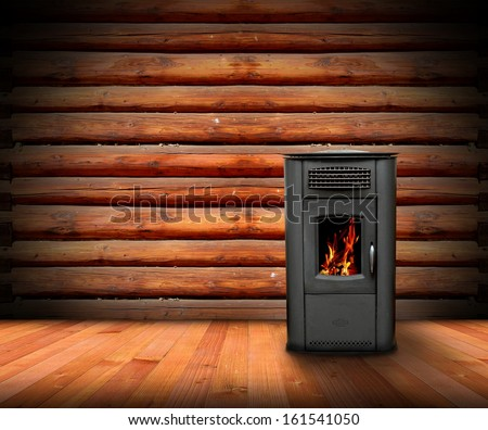 warm interior of a lodge with wooden finishing and burning stove - stock photo