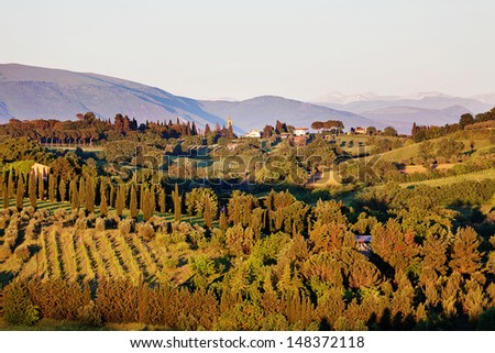 Warm late afternoon sunlight across the landscape of Perugia in the Umbrian region of Italy