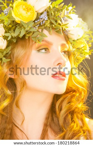 Warm portrait of sensual woman with flowers in studio