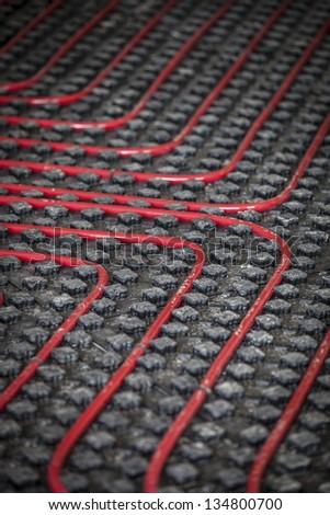 Warm radiant floor construction installation - stock photo