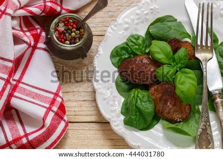 Warm salad of chicken liver with spinach and Basil. Selective focus - stock photo