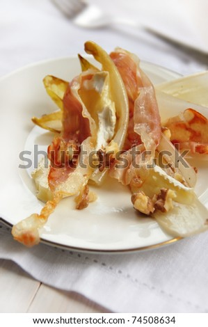 warm salad of chicory, walnuts and brie cheese - stock photo