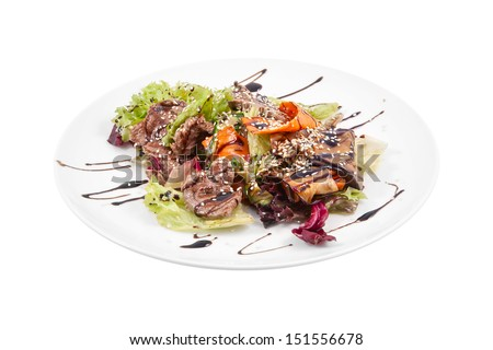 Warm salad with beef isolated on white