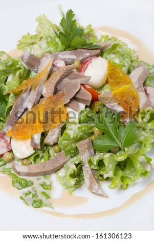 Warm salad with beef tongue, with quail eggs and ginger dressing.