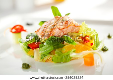 Warm Salad with Grilled Salmon and Vegetables - stock photo