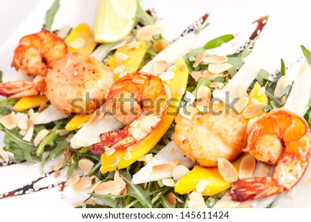 Warm salad with scallops and shrimps - stock photo