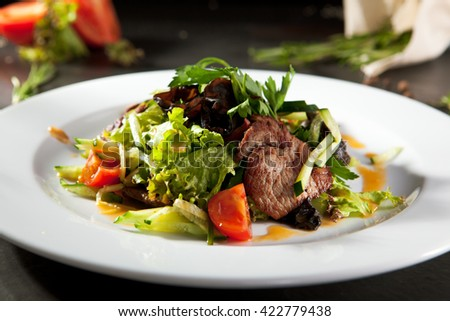 Warm Salad with Spicy Veal - stock photo