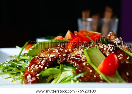 Warm salad with veal. Tasty and nutritious food - stock photo