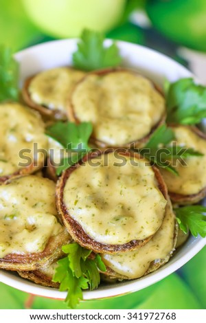 Warm salad with young marrow squash and spicy dip - stock photo