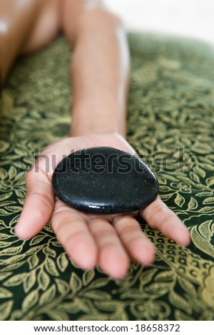 warm stone massage and therapy - stock photo