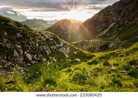 Warm sunset in Julian Alps - stock photo