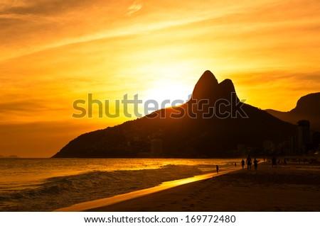Warm Sunset on Ipanema Beach, Rio de Janeiro, Brazil - stock photo