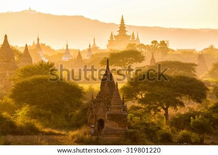 Warm sunset on the pagoda landscape in the plain of Bagan, Myanmar (Burma) - stock photo