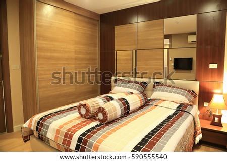 warm bedroom design. Modren Bedroom Warm Tone Of Luxury Interiors Design The Bedroom In Condominium As  Background On Bedroom Design