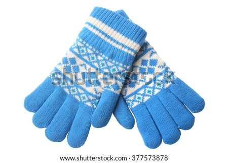 Warm woolen knitted gloves isolated on white background - stock photo