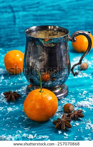 warming drink mulled wine on bright blue background.Photo tinted - stock photo