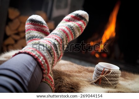 Warming up by the fireplace - stock photo