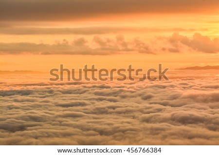 Warmly sunrise with slowly cloudy mountain of DOI ANG KHANG ,ChiangMai ,Thailand.