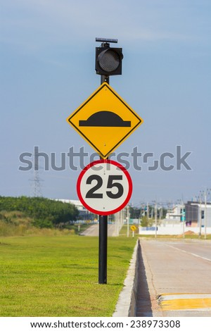 warning bump sign speed limit on the road - stock photo