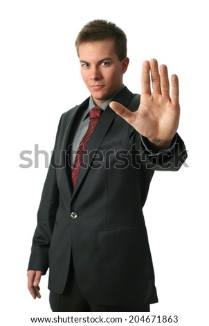 Warning businessmen holding his palm up isolated on white. Palm in focus.