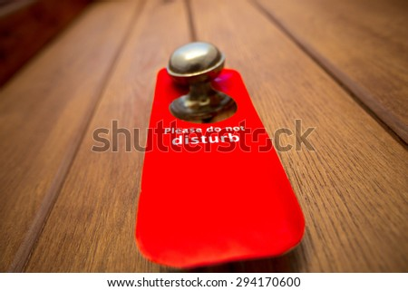 Warning Do not disturb label on hotel doorknob, close up - stock photo