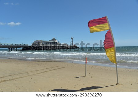 Warning flag and Bournemouth pier, Dorset