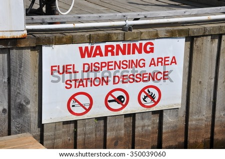 Warning fuel dispensing area sign - stock photo
