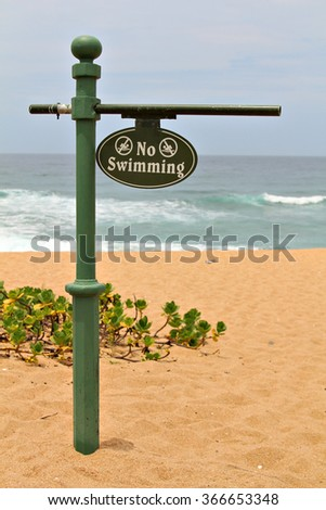 Warning no swimming sign on a beach. - stock photo