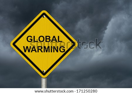 Warning of Global Warming Sign, An American road warning sign with words Global Warming with stormy sky - stock photo