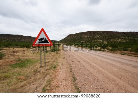 Warning of road sign for trucks - road going to hills, Namibia - stock photo
