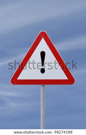 Warning or attention sign with a sky background - stock photo