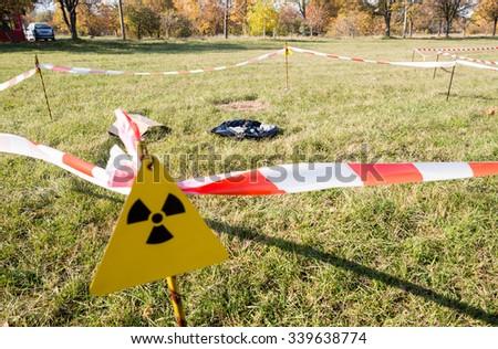 Warning radiation sign marking a zone of alienation with potentian radioactive hazard. - stock photo