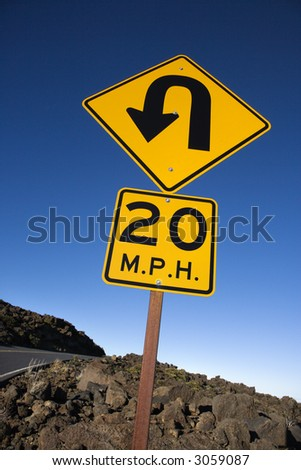 Warning road sign indicating curve and speed limit in Haleakala National Park, Maui, Hawaii. - stock photo