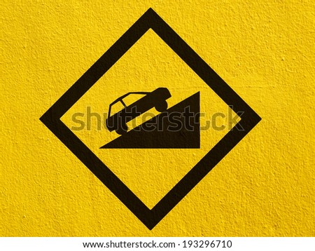 warning Road Sign painted on a stucco wall outside - stock photo