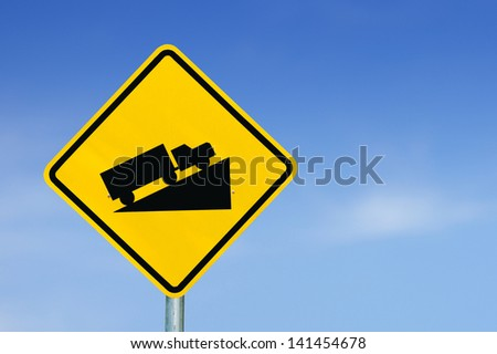 Warning road sign up to hill. on blue sky - stock photo
