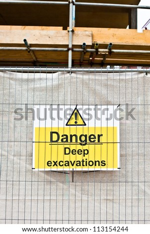 Warning sign about excavations at a construction site