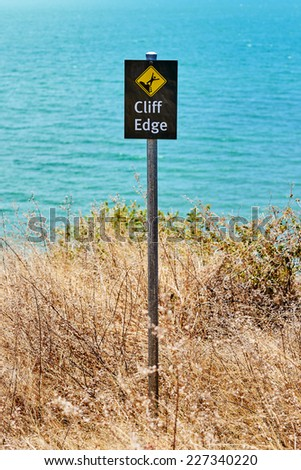 Warning sign cliff edge - stock photo