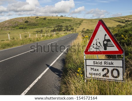 warning sign concerning dangerous road surface - stock photo