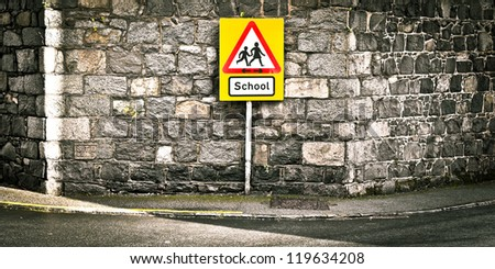 Warning sign for a school on a roadside - stock photo