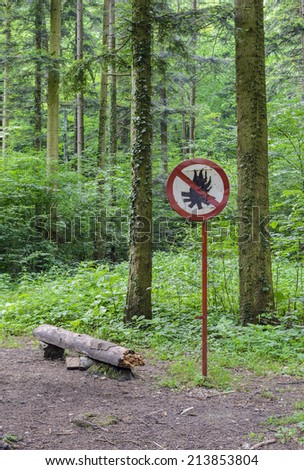 Warning sign for banned fire in forest - stock photo