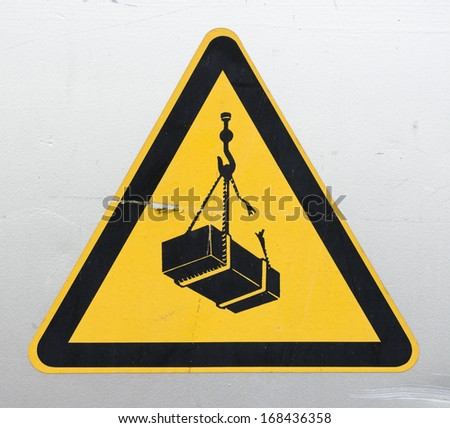 Warning sign for cranes - stock photo