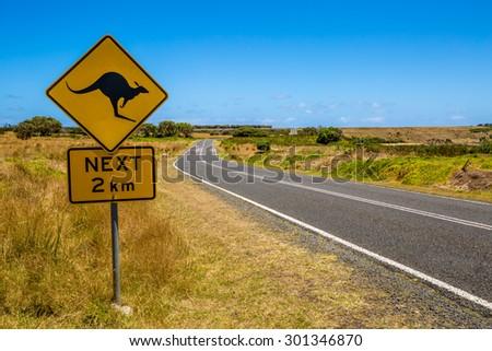 Warning sign for kangaroo crossing on Austalian country road. - stock photo