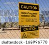 Warning sign for radio frequency radiation at solar plant - stock photo