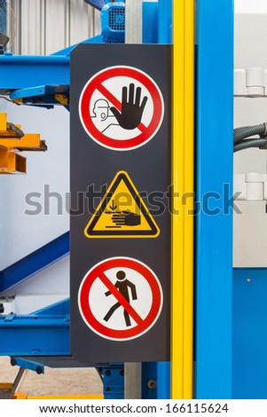 Warning sign for safety on machine, no entry and be careful hand - stock photo