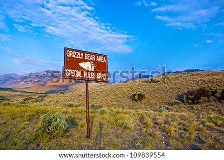 Warning sign identifying an area frequented by western Grizzly Bears. - stock photo