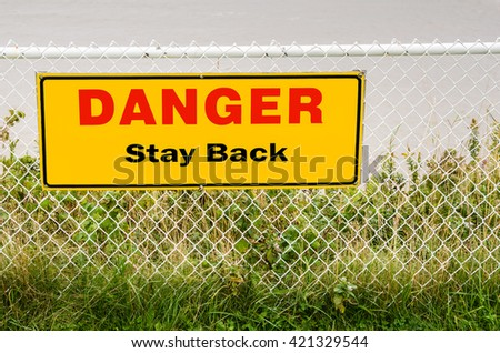Warning Sign on a Chain-link Fence - stock photo